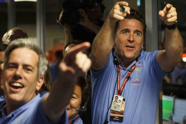 Adam Steltzner (right), the man who lead the team responsible for the Curiosity's descent and landing systems, responds to news that Curiosity has arrived on Mars (credit: Brian van der Brug/Los Angeles Times-POOL)