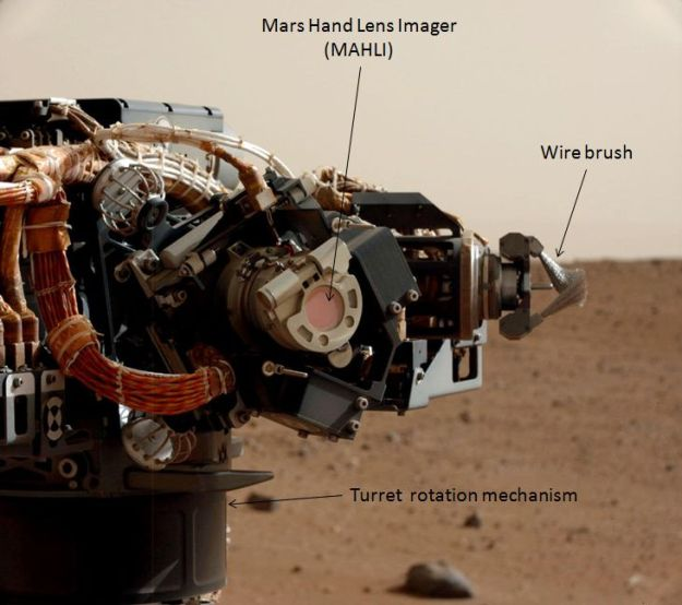 The MAHLI camera - the LEDs can be seen in the ring surrounding the circular lens, still protected in this image by its dust cover