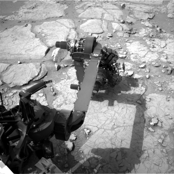 A Navcam image from curiosity as the APXS and MAHLI are deployed to examine potential targets for drilling in 2013