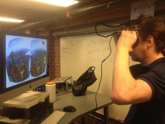 Rod Humble tries out Oculus Rift in a photo released on July 18th