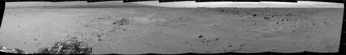 "The road ahead: a mosaic panorama captured by Curiosity's Navcams after the Sol 376 traverse. The rise on the left of the image is part of ""Mount Sharp""; the most distance highlands are the walls of Gale Crater"