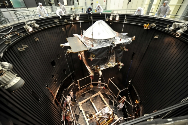 MAVEN is lowered in a Thermal Vacuum (TVAC) chamber where its systems will be tested in an environment simulating interplanetary space (image courtesy of Lockheed Martin)
