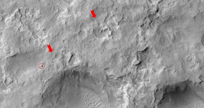 NASA's Curiosity Mars rover and tracks left by its driving appear in this portion of a Dec. 11, 2013, observation by the The rover is near the lower-left corner of this view. For scale, the two parallel lines of the wheel tracks are about 3 metres (10 feet) apart.