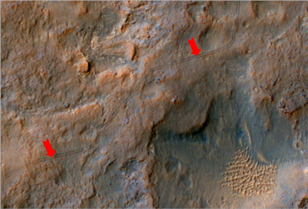 "Tracking Curiosity's progress towards ""Mount Sharp"" - the arrows point towards to tracks left by the rover as it heads southwest towards a gap in the dune field (seen lower right) sitting between it and the foothills of it's primary destination (click to enlarge)"