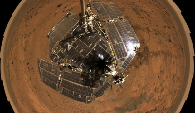 "A ""selfie"" by Opportunity, showing the pristine solar panels as seen from the rover's mast-mounted Panoramic Camera"
