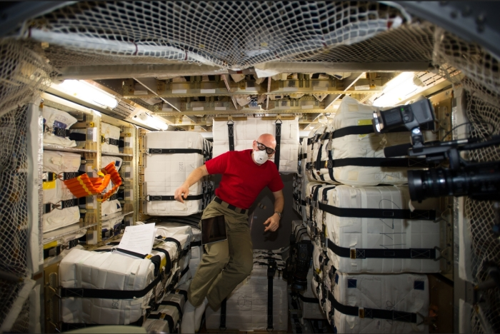 Dr. Alexander Gerst of the European Space Agency, gives some idea of the interior volume in an European ATV during the unloading of the Georges Lemaître following its arrival at the ISS on August 12th.