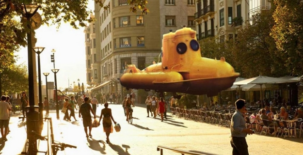 One of the Magic Leap promotional images: a yellow submarine apparently floats down a street the Magic Leap wearer is walking along