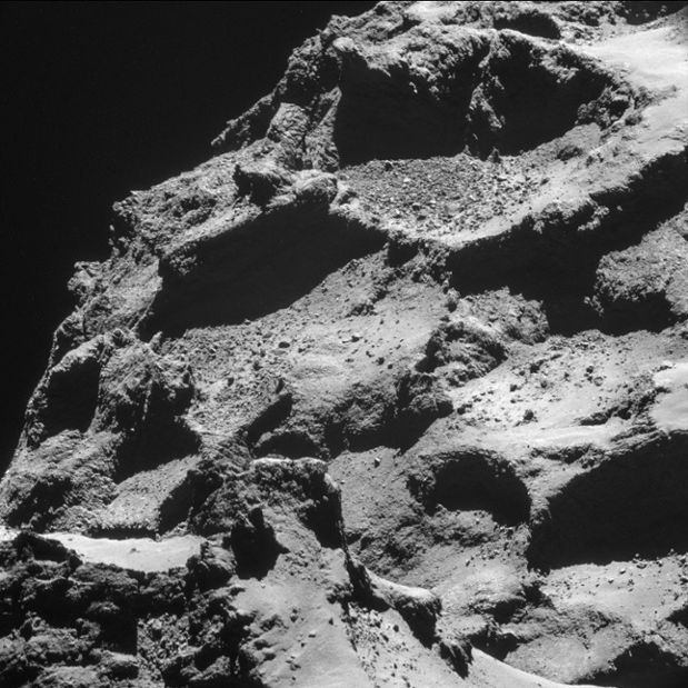 And closer still - rubble-filled depressions show the rough environment into which Philae was descending. Some of the depressions may actually be gas vents which will become more active as the comet continues to approach the Sun
