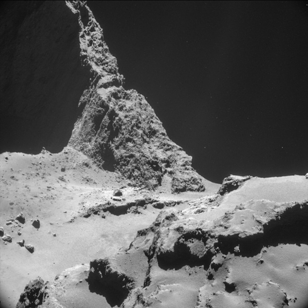 A close-up of the surface of 67P/C-G captured by Rosetta's navigation cameras on Tuesday, November 11th showcases a sttep cliff, demonstrating that comets have a complex composition, reather then being simple balls of rock, ice and debris