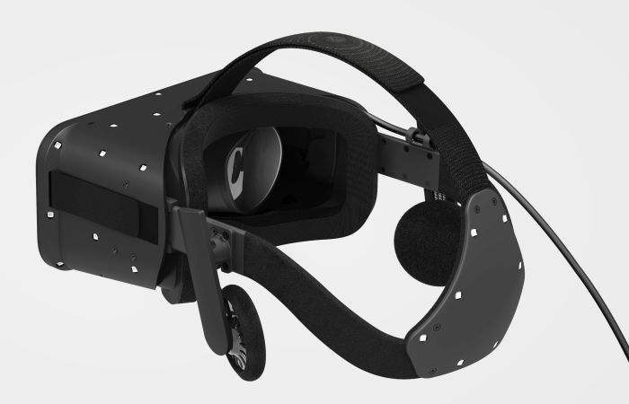The Oculus Crescent Bay prototype showing the Samsung Gear-type head harness with motion tracking sensors on the back and the integrated headphones