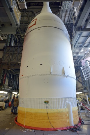 The Orion capsule, hidden under the protective shroud of the Launch Abort System, and with the simulated Service Module  beneath it similarly hidden by cylindrical payload fairings, was mated to its Delta IV launch vehicle earlier in November