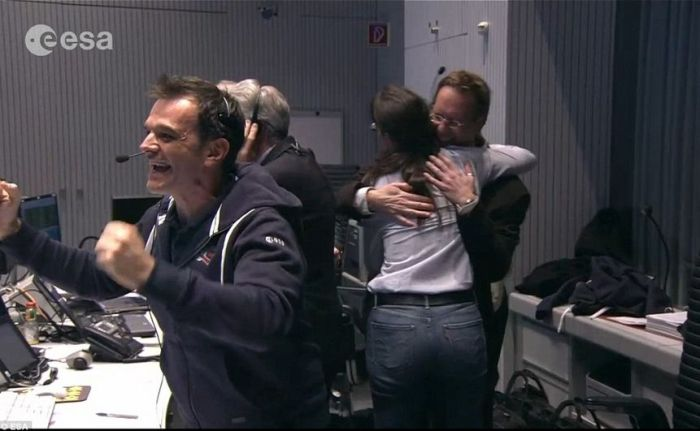 Mission control personnel react to the first telemetry received from Philae on it's initial contact with the surface of comet 67P/C-G
