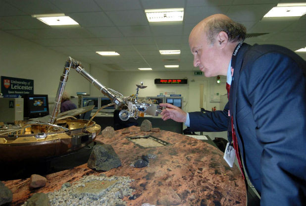 Dr. Mark Sims of the University of Leiceter, who lead the engineering team responsible for Beagle 2, seen with another model of the lander (image: University of Leicester)