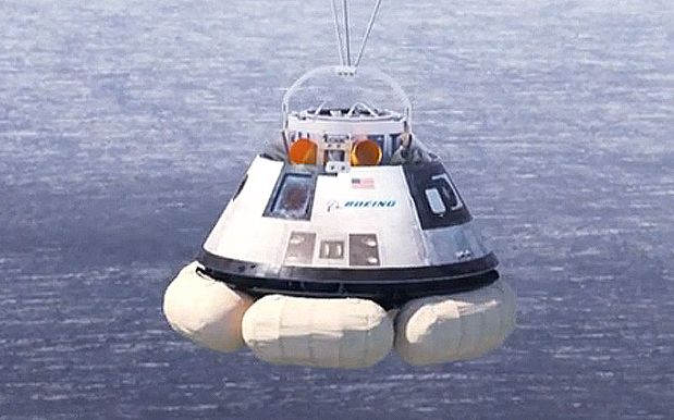 A Boeing CST-100 test article undergoing drop and floatation tests in 2014