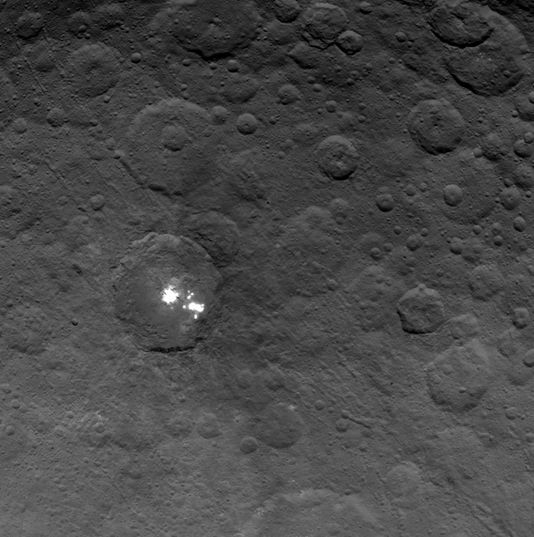 A June 6th image of the bright spots within a crater on Ceres, captured by Dawn on June 6th, 2015, from a distance of