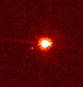 Eris and Dysnomia (bright spot, lower left) imaged by the Hubble Space Telescope in 2007.