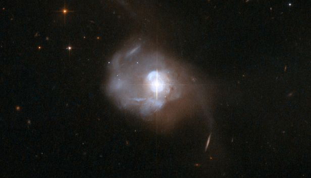 "Mrk-231, in the constellation of Ursa Major, as seen by the Hubble Space Telescope. The bright ""star"" at its centre is the quasar - image: NASA / ESA, the Hubble Heritage (STScI/AURA)-ESA/Hubble Collaboration, and A. Evans (University of Virginia, Charlottesville/NRAO/Stony Brook University"