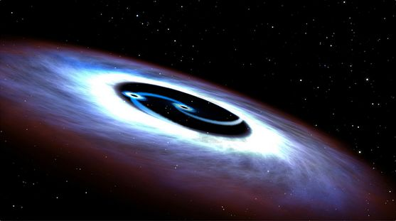 "An artist's impression of the two black holes ""powering"" the quasar at the heart of galaxy Mrk 231 - image: NASA / ESA, via Astronomy Now"