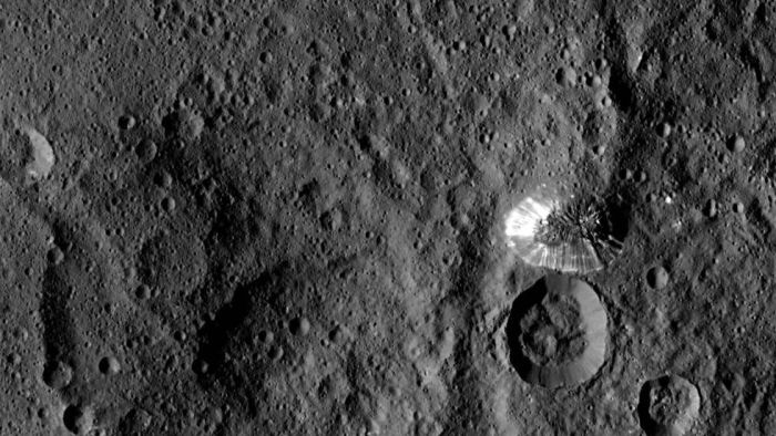 Ceres' strange, flat-topped mountain with brightly-streaked flanks - but not apparent debris left from any flow of material, and an oddly well-defined perimeter