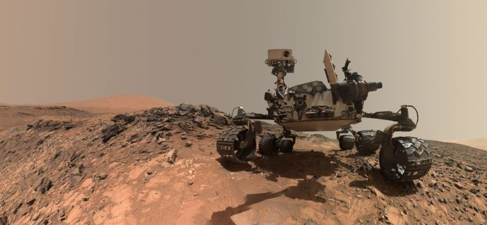 "A low-angle self-portrait produced from multiple images captured by the Mars Hand Lens Imager (MAHLI) camera mounted on the ""turret"" at the end of the rover's robot arm. The images were taken on August 5th, as the rover was parked at the ""Buckskin"" rock formation from which it gathered drill samples"