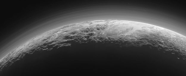 "Back lit by the sun: Pluto's hazy atmosphere seen from just 18,000km (11,000 miles) and 15 minutes are the point of closest approach to the planet by the New Horizons spacecraft on July 14th, 2015. To the upper right of the planet can be seen the icy expanse of ""Sputnik Planum"", bordered below and to the left by tall mountains, and to the right by what appears to be glacial outflows. Image courtesy of NASA / JHU / APL,"