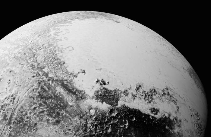 "A synthetic perspective view of Pluto, based on the latest high-res received from New Horizons presents a view of Pluto from around 1,800 km (1,100 mi) above Pluto's equatorial area. Towards the bottom of the image is the cratered and dark region dubbed ""Cthulhu Regio"", and above it, the bright ""heart"" of Pluto, showing the icy plains of ""Sputnik Planum"". The images used to create this view were captured from a distance of 80,000 km (50,000 mi) from Pluto"