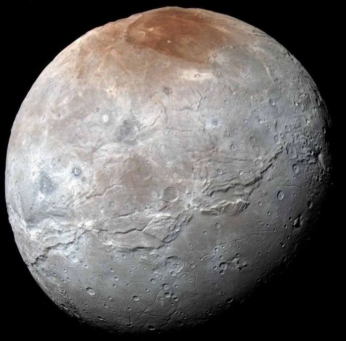Charon as revealed in the highest resolution images yet returned of that tiny world by New Hotizons (image: NASA/JPL / JHUAPL / SwRI)