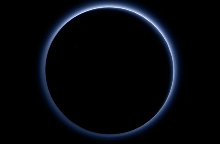 The blue haze of Pluto's atmosphere
