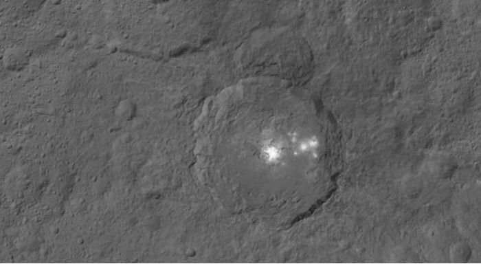 Occator crater and its brights spots images from directly overhead and a distance of 1,470 km (915 miles) by the Dawn space vehicle