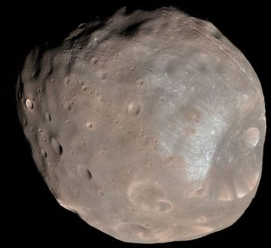 Phobos as seen by the Mars Reconnaissance Orbiter in October 2003. In this false colour image, many of the grooves covering the little moon's surface can be clearly seen.