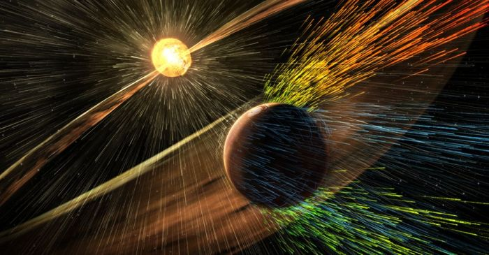 An artist's impression of the solar wind shredding ions from Mars' atmosphere