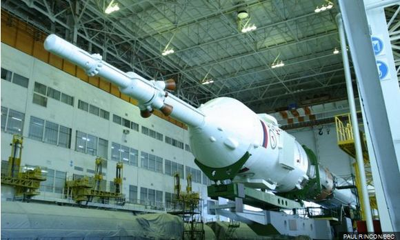 The Expedition 47 Soyuz vehicle, mated to its launch booster, emerges from the assembly hanger for the short train ride to the launch pad, where it was erected ready for lift-off, on Saturday, December 12th