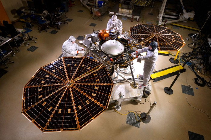 NASA's InSight Mars lander spacecraft in a Lockheed Martin clean room near Denver. As part of a series of deployment tests, the spacecraft was commanded to deploy its solar arrays in the clean room to test and verify the exact process that it will use on the surface of Mars.