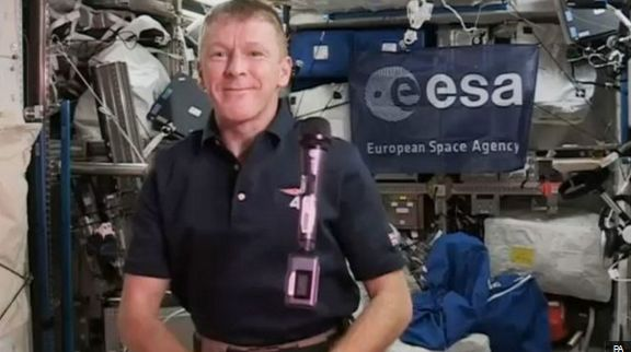 Peake aboard the ISS during a press conference