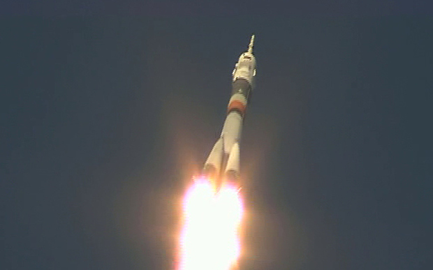 The Soyuz vehicle carrying the Expedition 47 crew to the ISS accelerates away from the launch pad, moments after lift-off on Tuesday, December 15th.