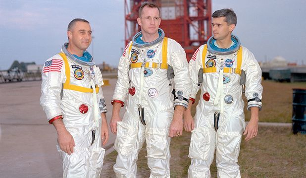 "Apollo 1: (l-to-r) Virgil I. ""Gus"" Grissom, Edward H. White II, and Roger B. Chaffee standing before the Apollo 1 launch vehicle, on January 17th, 1961"