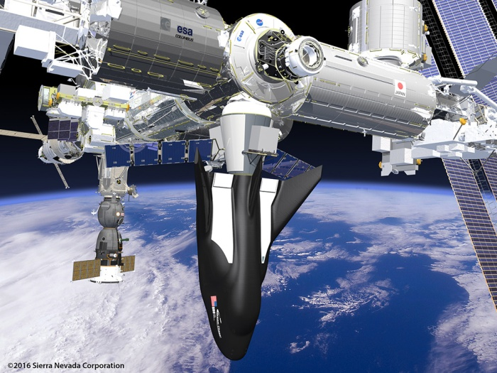 An artist's concept of the Dream Chaser Cargo docked with the ISS during a resupply flight