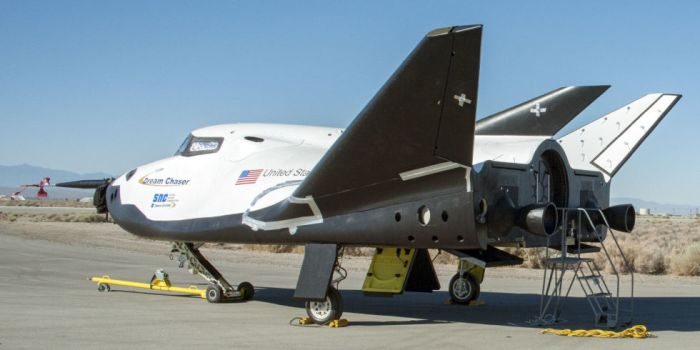 "Dream Chaser was unique among the commercial crew transportation proposals as it was based on a ""lifting body"" design , allowing to re-enter the Earth's atmosphere and glide to a landing on a conventional runway - aspects which still make it a very flexible vehicle"
