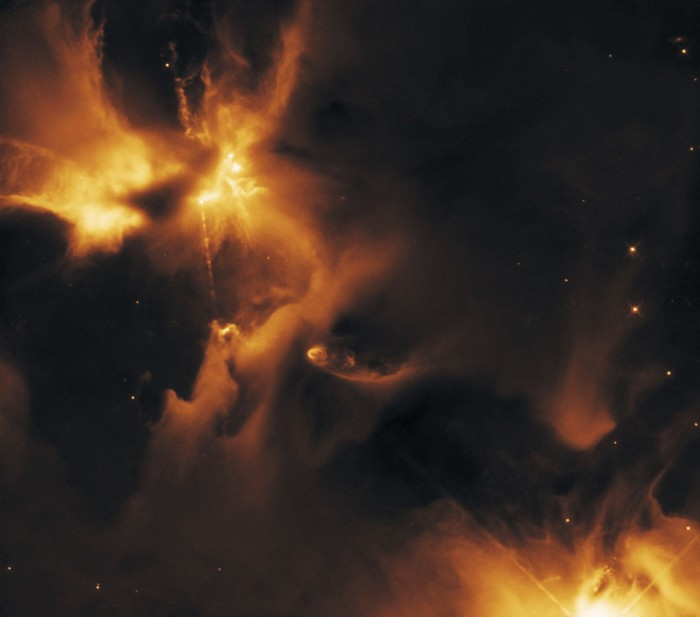"Another view of the ""stellar nursery"" where stars are being formed, captured by Hubble. HH24 can be seen at the top left, with further HH objects just visible in the lower right. Both this image and the one above were captured in infrared, allowing Hubble to ""look through"" the intervening clouds of dust and ""see"" the jets"