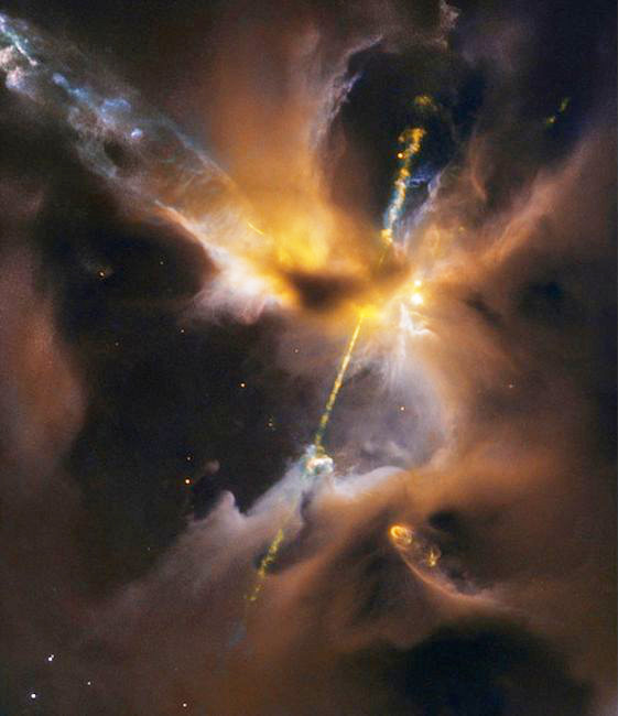 "Two beams of light slice through space from the polar regions of a new-born star. Captured by the Hubble Space Telescope, the image was immediately dubbed ""the cosmic lightsaber"" (image: ESA / NASA / D. Padgett / T. Megeath / B. Reipurth) - click for full size"