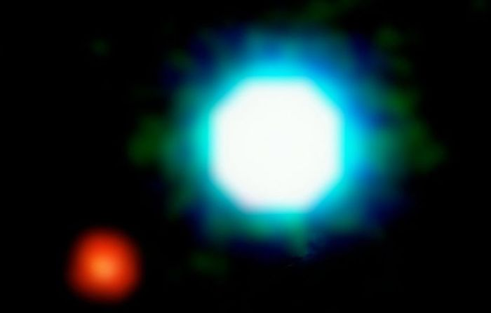 a composite image of the brown dwarf object 2M1207 (blue-white) and the planet 2M1207b, seen in red, located 170 light years from Earth in the constellation Centaurus. The photo is based on three near-infrared exposures with the taken with the 8.2-m VLT Yepun telescope at the ESO Paranal Observatory. Credit: ESO