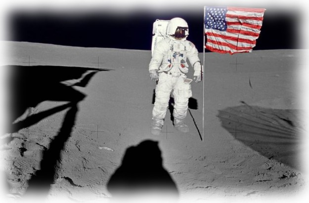 """Astronaut Edgar D. Mitchell, Apollo 14 Lunar Module pilot stands by the deployed U.S. flag on at the Frau Mauro landing site on February 5th, 1971. He was photographed by astronaut Alan B. Shepard Jr., mission commander. While astronauts Shepard and Mitchell descended in the Lunar Module """"Antares"""" to explore the Fra Mauro region of the moon, astronaut Stuart A. Roosa, command module pilot, remained with the Command and Service Module """"Kitty Hawk"""" in lunar orbit."""