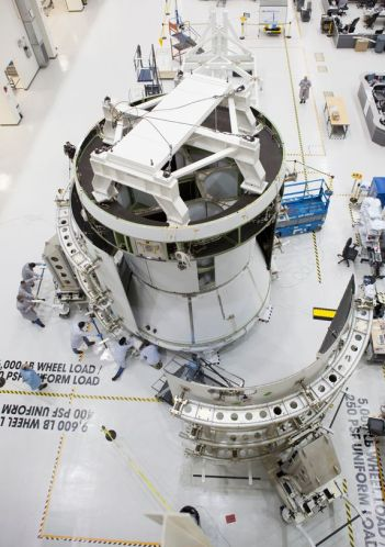 A European Orion Service Module having the launch payload fairings attached to it. The Orion vehicle is attached to the circular part of the Service module visible at the top. This was a structure flight test article used in Orion's first test flight in December 2014 (image: Airbus / ESA)