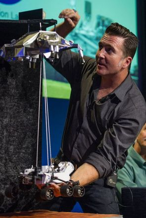 Adam Steltzner demonstrates the sky crane landing system at a press briefing ahead of MSL's arrival on the surface of Mars in August 2012