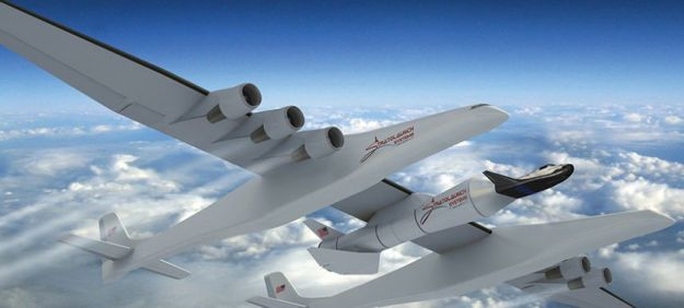 An Artist's impression of the reduce-size Dream chaser crewed vehicle and booster being lifted to launch altitude by the Stratolaunch aircraft