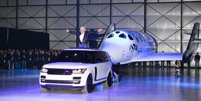 VSS Unity is rolled out in a ceremony which saw it christened by Professor Stephen Hawking and Sir Richard Branson's year-old granddaughter