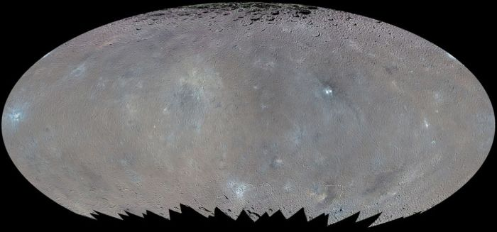 A false colour elliptical map of Ceres showing that Occator (just right of centre) is not the only bright spot on the tiny planetoid others, mostly associated with young (around 70-150 million years old) craters