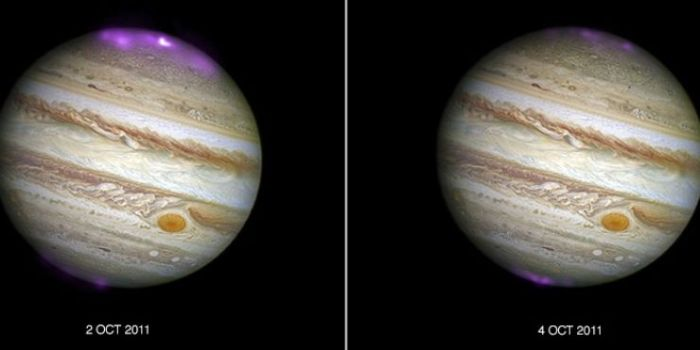Jupiter's massive aurora displays in 2011, the result of a massive CME striking the planet (credit: NASA / CXC / UCL / STScI)