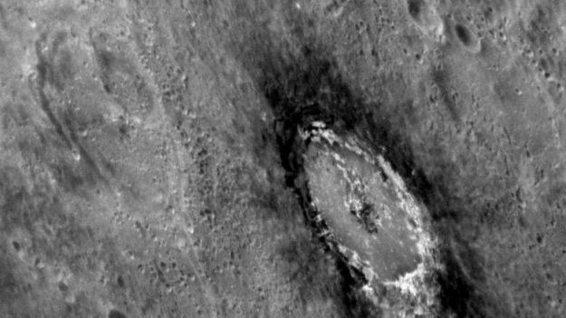 "This oblique image of the impact crate Basho on Mercury shows the distinctive dark halo of ""Low Reflectance Material"" (LRM), originally thought to be carbon contained within the cometary fragment which created the crater (and many like it across Mercury), but which now appears to have come which was excavated from depth when the crater was formed. Basho is also renowned for its bright ray craters, which render the crater easily visible even from very far away. Credit: Courtesy NASA/Johns Hopkins University Applied Physics Laboratory/Carnegie Institution of Washington"