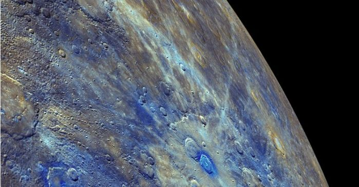 An enhanced colour image from MESSENGER highlights Mercury's low-reflectance material (seen in blue) and its association with impact-excavated material around relatively young crater's on the planet's surface (credit: NASA/JPL / Johns Hopkins University Applied Physics Laboratory / Carnegie Institution of Washington